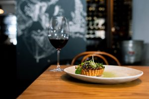 Glass of Stonegaze red wine with food